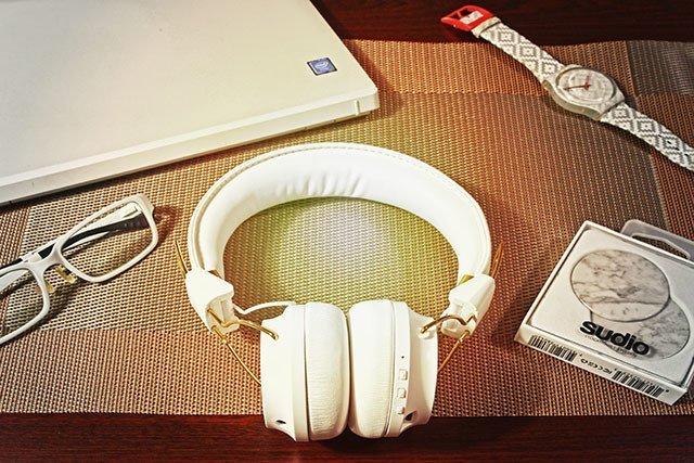 Sudio Regent headphones complementing my white traveling gear.