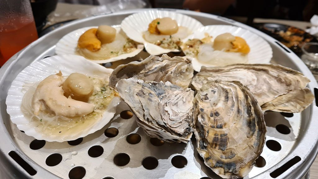 Freshly steamed oysters and scallops